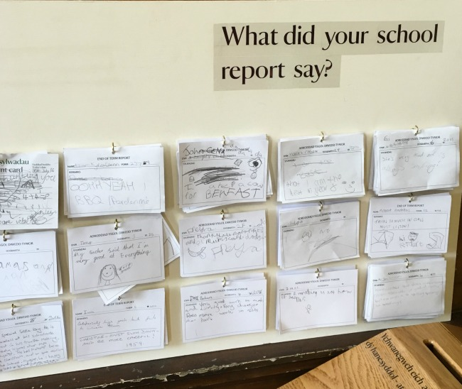board-with-what-did-your-school-report-say?-and-writing-on-pieces-of-paper-hung-on-hooks