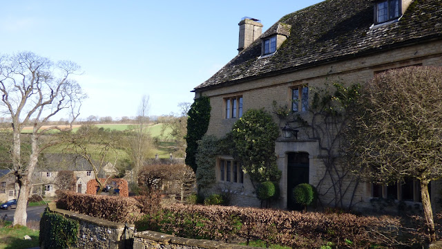 A honey coloured stone property in the village of Upper Slaughter, Cotswolds