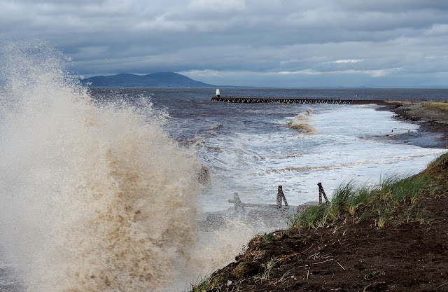 Photo of wild waves crashing onto the shore at Maryport during Storm Brian