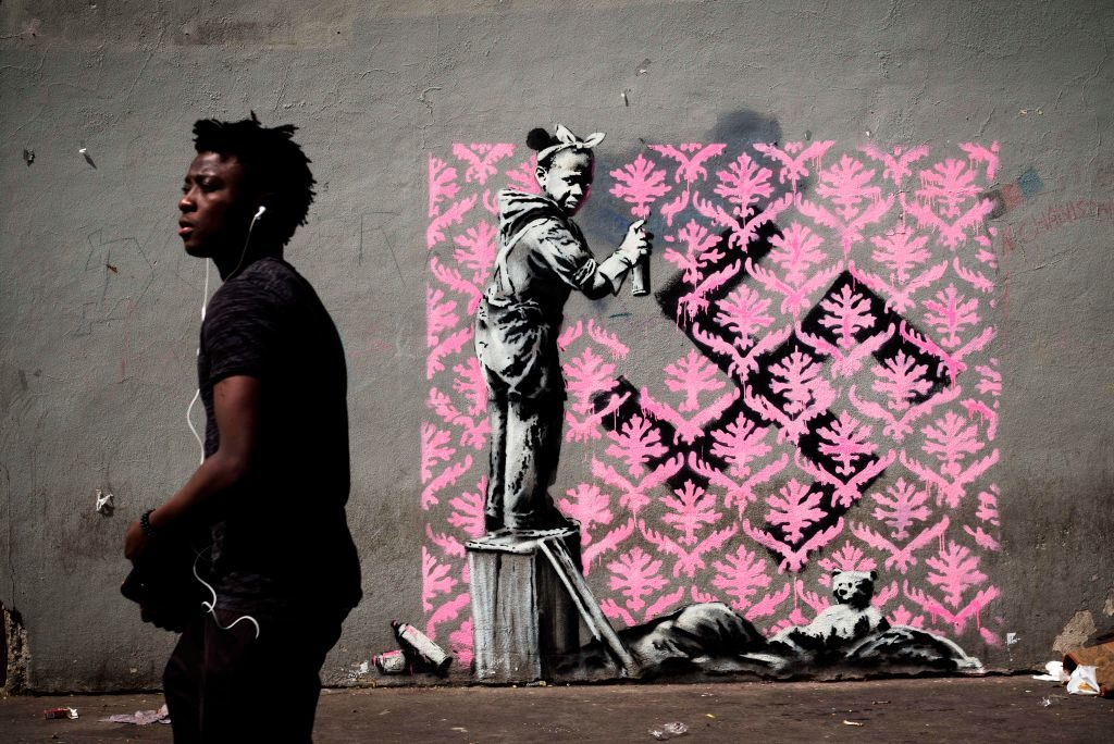 Banksy has painted walls in Paris with murals on the theme of migration
