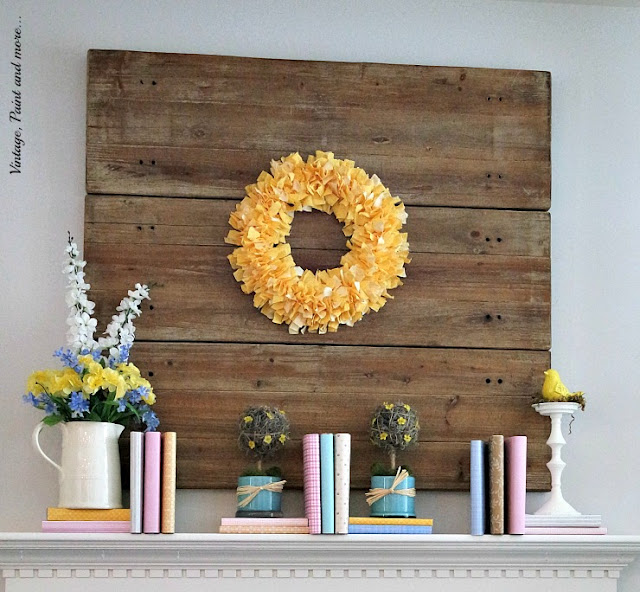 diy fabric rag wreath oversees a pastel mantel of paper covered books, diy topiaries, faux bouquets in a vintage pitcher