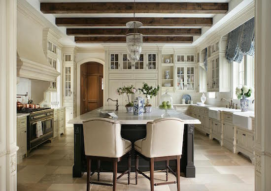 Breathtaking French blue and white kitchen with wood beams white cabinetry by Enchanted Home