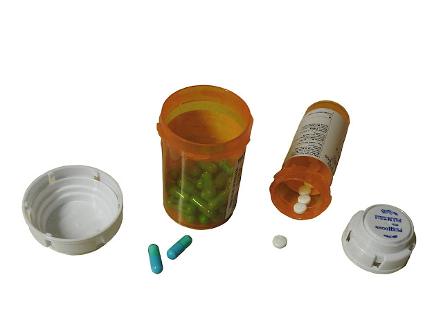 Generic capsules in bottles.
