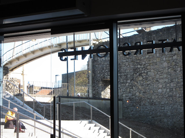 Looking out from Waterstones Bookshop Cafe at the old walls of Southampton across new steps to precinct.