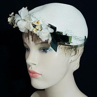 https://websites.godaddy.com/en-US/editor/787c8c2c-4eb9-4f92-9d2f-f257b7b660f6/c66351fb-c03e-4b49-8cc0-6e57ae451592?olsPage=products%2Fvintage-40s-flower-accented-ladies-hat&page=12