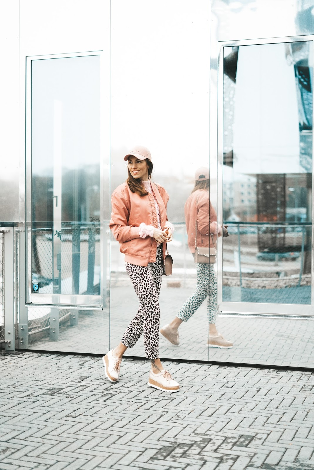bomber jacket leo print pants outfit