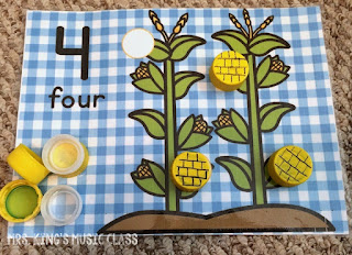 Princesses Don't Do Math – Number Mat Ideas for a Reluctant Learner.  You'll love these number mat ideas for getting your reluctant preschooler playing, counting and adding their way to success.  Number mats are great for developing number sense and these mats work with bottle caps!  They can work with playdough, rocks, and more but I think you'll like how perfectly the bottle caps can work with any theme.  Great for preschool and kindergarten aged students in workstations or at home.