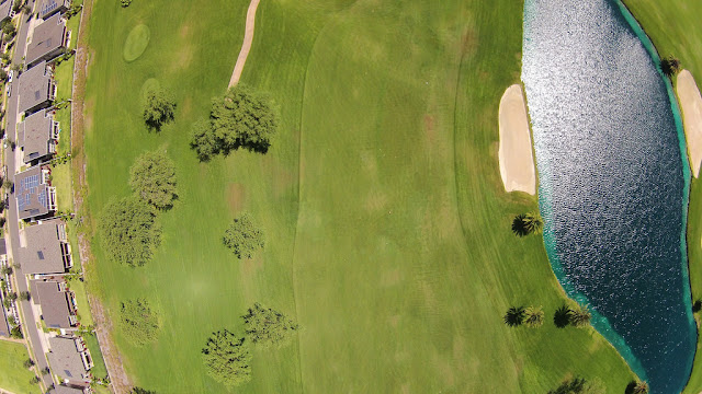 Aerial view of golf courses with warm season grass