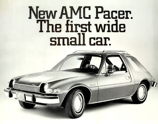 "Composite image in black and white of made up add for AMC Pacer with the text ""New AMC Pacer. The first wide small car""."