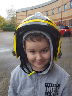 Dan Jon wearing a Fire Helmet
