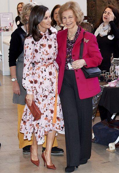 Queen Letizia wore a new floral print midi shirtdress by Hugo Boss at charity market Rastrillo Nuevo Futuro. Queen Sofia
