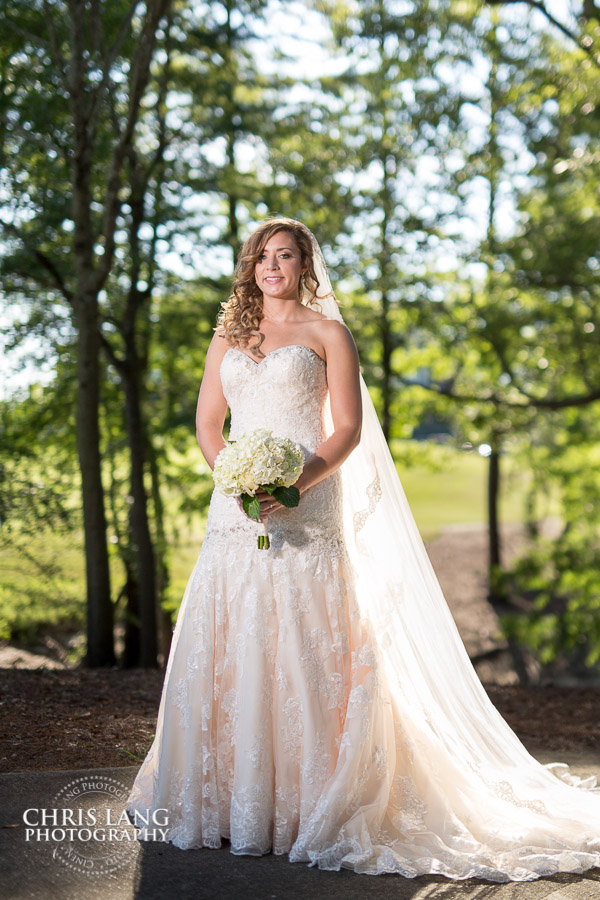 A Bride in her wedding dress at River Landing Wallace NC