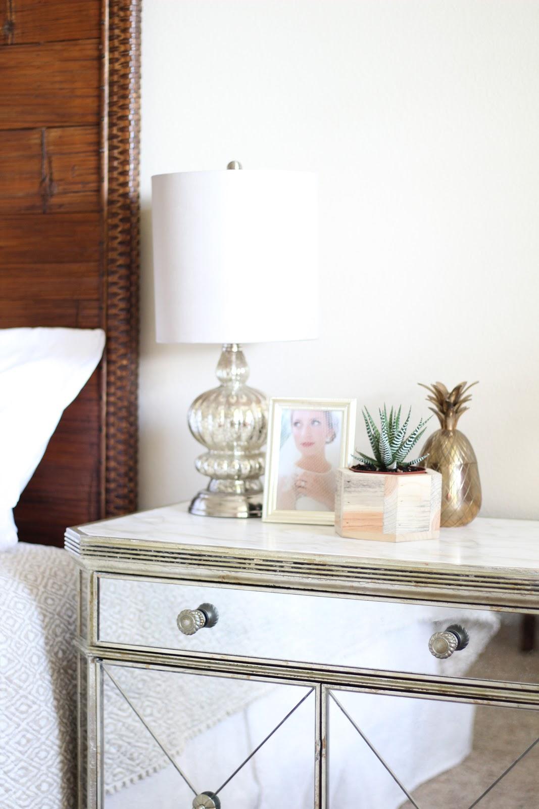 Nightstand (similar)   Brass Pineapple (similar)   Lamp (similar)   Wood  Plant Pot (similar)