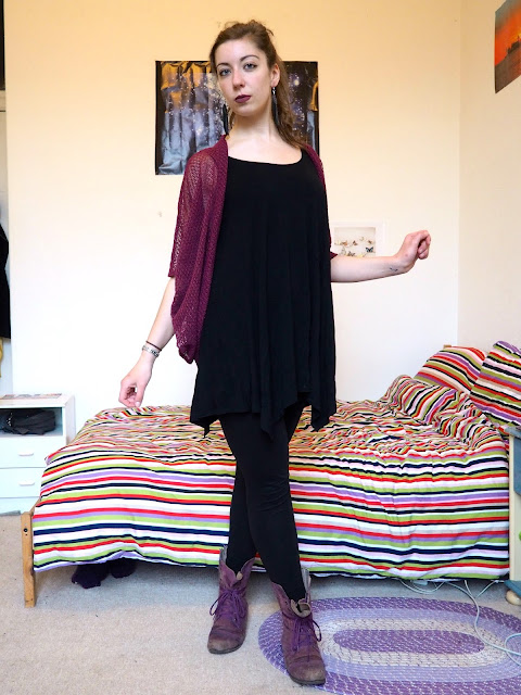 Pull the Lever   Disneybound Yzma outfit of black slouch dress, leggings, pink knit cardigan, and purple combat boots