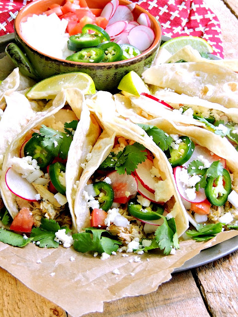 Creamy Slow Cooker Green Chile Chicken Tacos on a tray