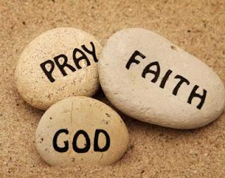 stones with words PRAY, FAITH, GOD printed on them
