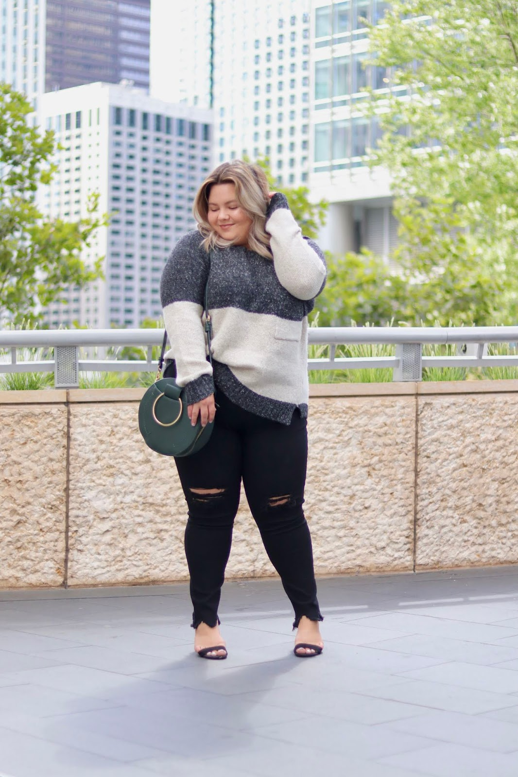Chicago Plus Size Petite Fashion Blogger, influencer, YouTuber, and model Natalie Craig, of Natalie in the City, reviews Chic Soul's black skinny jeans and oversized fall sweater.