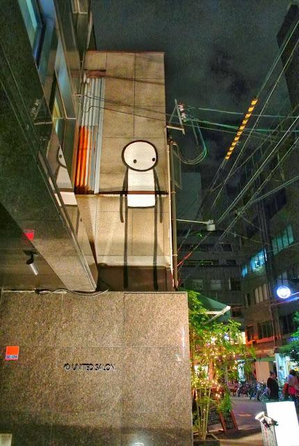 British Street Artist Stik paints a new street piece on the streets of Osaka, Japan. 5