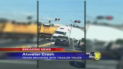 Train smashes into semi-truck stuck on railroad tracks