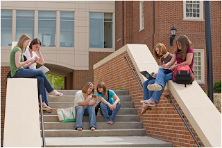 Students on stairs on a campus