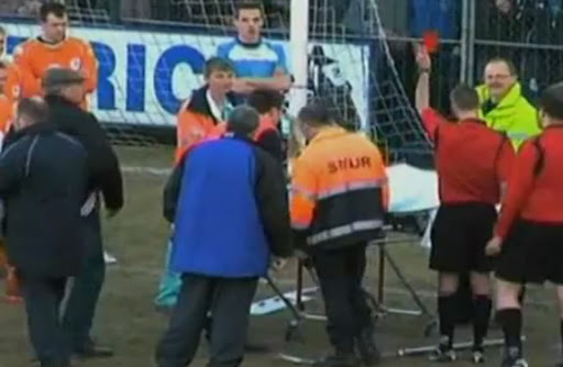 Julien Lecomte is shown red card whilst being carried off on a stretcher
