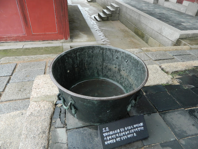 The bucket of water which is said to ward off the evil fire