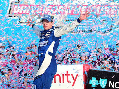 A J Allmendinger celebrates in Victory Lane after winning the NASCAR Xfinity Series Drive for the Cure 250 presented by Blue Cross Blue Shield of North Carolina at Charlotte Motor Speedway.