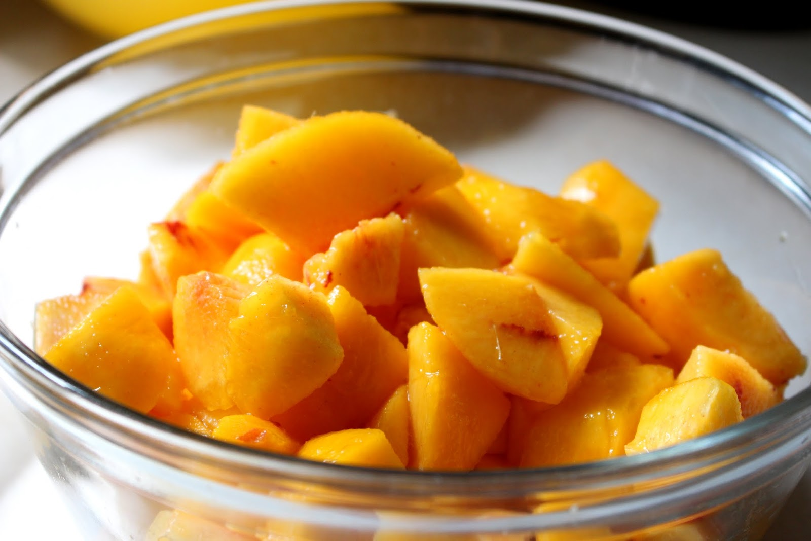 cut up peaches - how to make peach blueberry dump cake - mehaffey moments