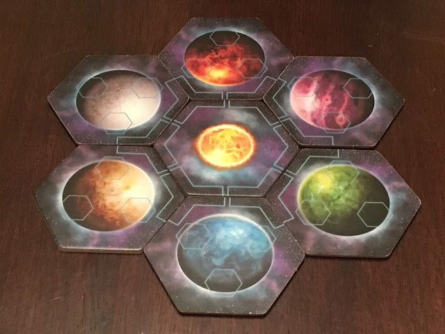 Horizons board game star system with planets, from Daily Magic Games; Photo by Benjamin Kocher
