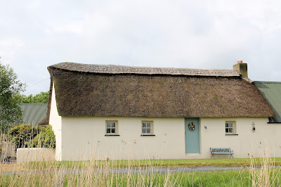 Thatched house view from the canal