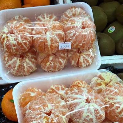 Voorgepelde mandarijnen