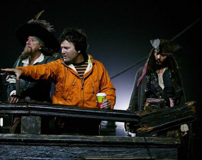 Gore Verbinski directing cast of Pirates of Caribbean -- Johnny Debb in background