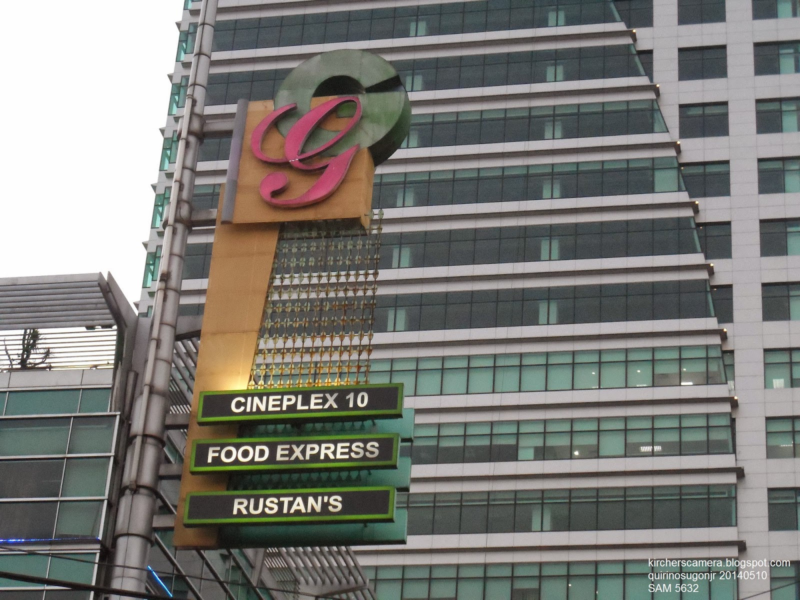 Gateway Mall's G logo. The logo consists of a script G in pink and a sans  serif G in green with a yellow background. Below the logo are the following  signs: Cineplex 10, Food Express, and Rustans