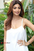 Bollywood Actress Shilpa Shetty Pos in White Gown at The Inauguration Of Shelar Make up Academy  0005.jpg