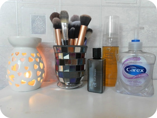 A picture of products for cleaning makeup brushes
