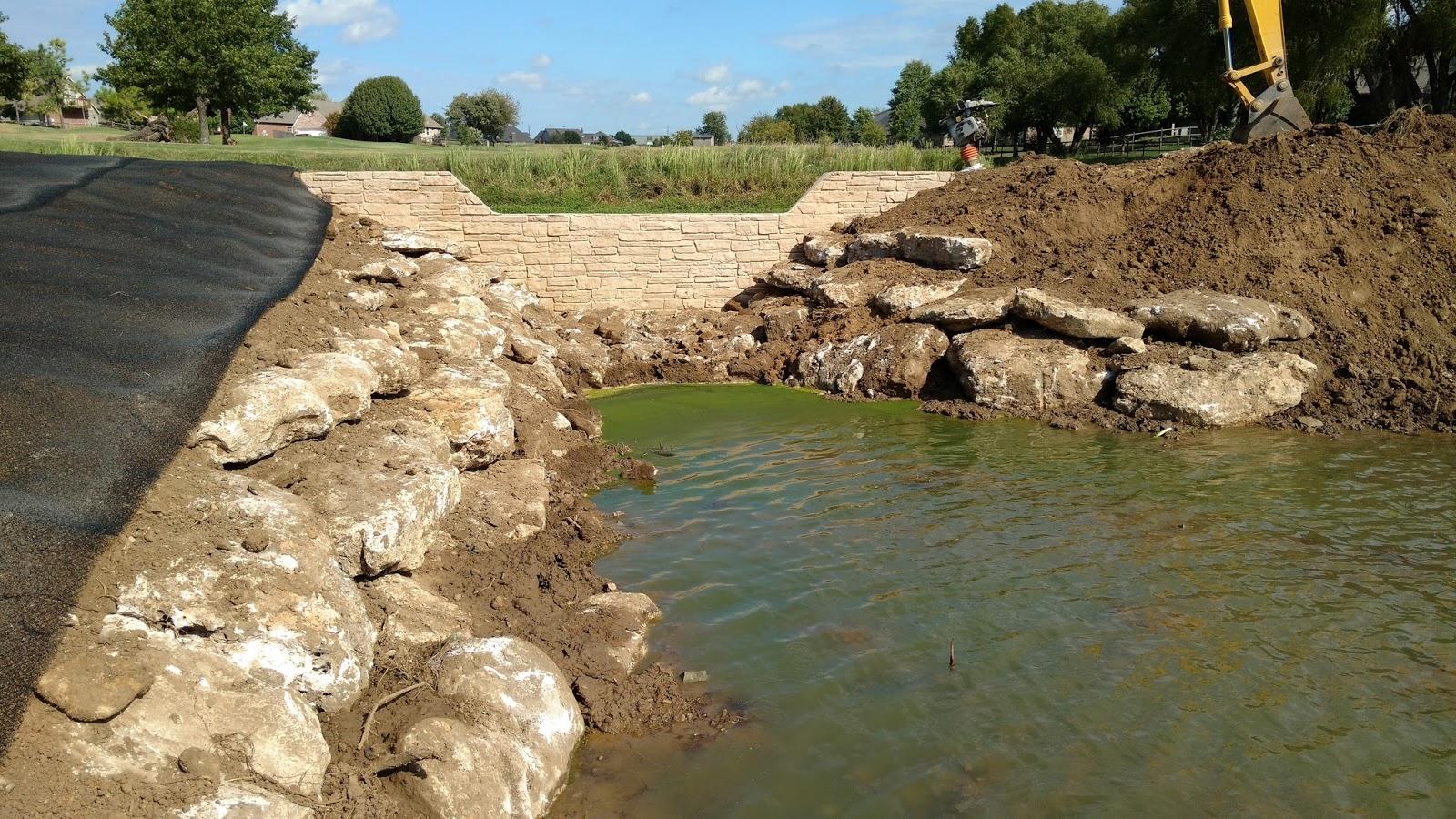 Grounds department blog 3 pond dam construction complete for Pond dam design