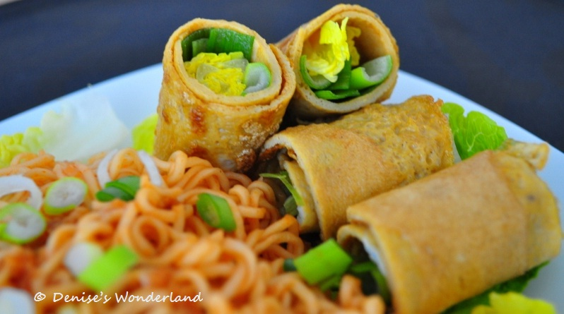 Egg roll wrapped with scallions