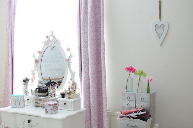 shabby chic style bedroom white dressing table with pink roses over and Cath Kidston accessories