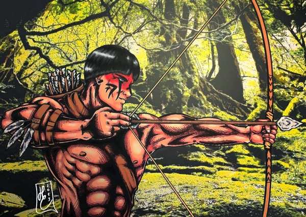 A Red Indian prince is hunting with  bow and arrow in the jungle