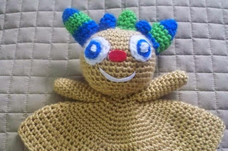 http://www.craftsy.com/pattern/crocheting/toy/free-huggy-monster-security-blanket/86043