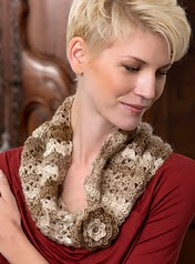 http://www.redheart.com/free-patterns/flowered-cowl