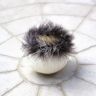 Feather-trimmed felted vessel by Kim Buchheit