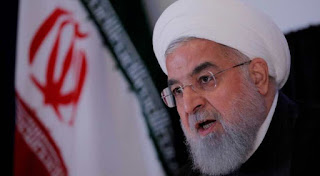 President Rouhani says Iran to continue expanding military might and missile work