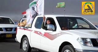 العراق : قوافل الدعم اللوجستي للعتبة العباسية تقدم المساعدات لمقاتلي الحشد الشعبي في الحويجة