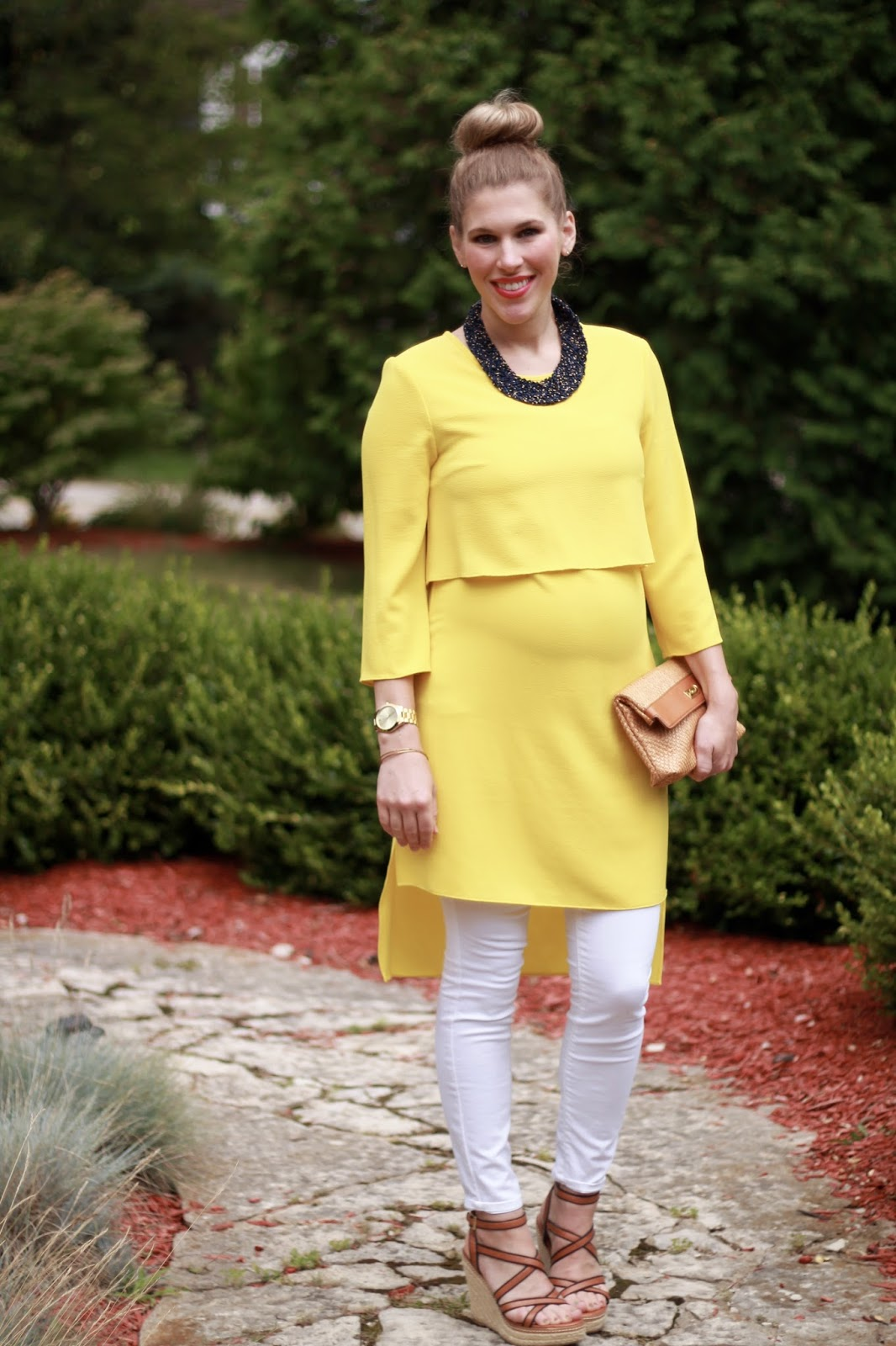 yellow tunic dress, white skinny jeans, blue beaded collar necklace, wedges, straw clutch, second trimester maternity outfit