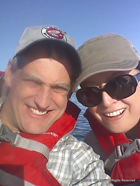 The artist and her husband, out on the lake in kayaks.