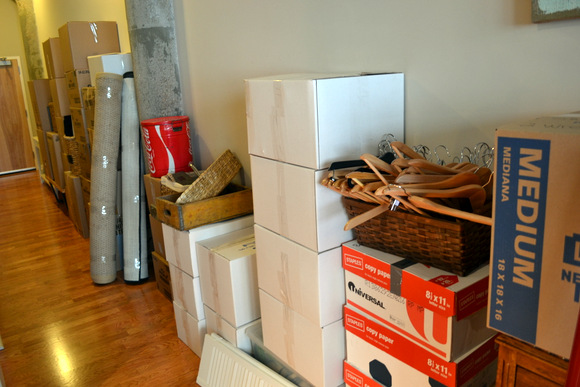 These moving boxes and taped up items are organized for moving day.