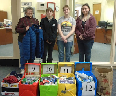 Fran Costa meets with Tri-County students Ashley O'Handley, Hannah Galante, and Damaris Carter, to organize items donated by the Tri-County community for homeless veterans