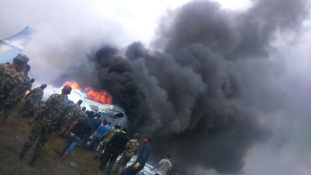 Photos: At least 38 dead after Bangladeshi plane with 67 passengers crashes and bursts into flames at airport in Nepa