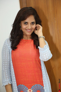 Actress Anasuya Bharadwaj in Orange Short Dress Glam Pics at Winner Movie Press Meet February 2017 (57).JPG